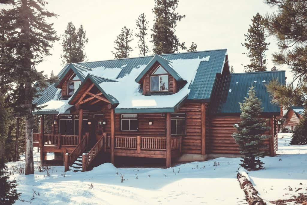 Utah cabin in winter with roof covered in snow